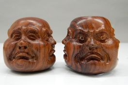Two wooden four faced Buddha heads. 4.5 cm high.