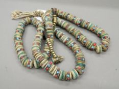 A Tibetan coral and turquoise set necklace. Approximately 97 cm long. each bead approximately 1.
