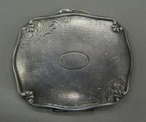 A Continental silver compact. 7.75 cm wide (56.5 grammes).