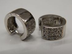 A pair of 9 ct white gold stone set earrings (5.