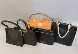 A quantity of various handbags
