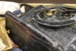 A vintage suitcase, handbags, scarves, etc.