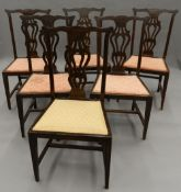 A set of six Edwardian mahogany dining chairs