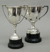 Two silver trophy cups, each on detachable base. Largest 19 cm high including stand (11.