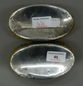 Two silver brushes. 13.5 cm wide.