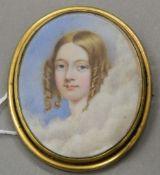 A 19th century miniature framed as a brooch. 7 cm high.