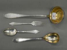 Four pieces of WMF cutlery. Ladle 30 cm long.