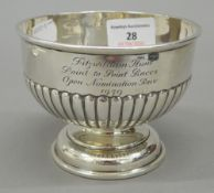 A silver pedestal bowl. 12 cm wide; 9 cm high (6.