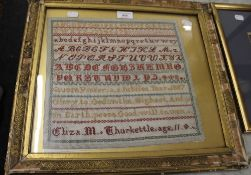 A framed sampler by Eliza M Thurkettle, aged 11, dated 1887. 46 x 42 cm overall.