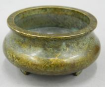 A small Chinese bronze censer. 7 cm diameter.