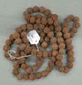 An Indian seed necklace (approximately 109 seeds).