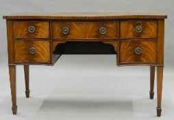 A mahogany serpentine sideboard. 122 cm wide.