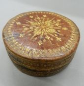 An 18th/19th century leather box and two shagreen boxes. The former 10 cm diameter.