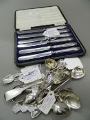 A cased set of silver handled knives together with a quantity of various silver spoons, tongs, etc.