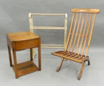 A pine towel rail, a side table and a folding chair. The towel rail 63 cm wide.