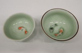 Two Chinese porcelain bowls decorated with fish. 7.5 cm and 6.5 cm diameter respectively.