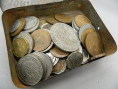 A tin of miscellaneous coins,