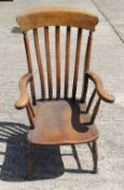 A Victorian elm seated grandfather chair. 62 cm wide.