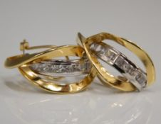 A pair of 18 ct yellow and white gold set earrings (3.