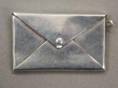 A large silver envelope form stamp box. 4 cm wide (7.3 grammes).