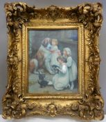 A decorative plaque in gilt frame. 39 cm high.