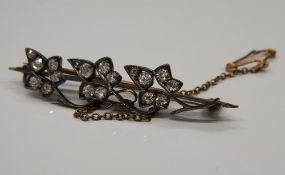 An Edwardian unmarked diamond leaf brooch. 4.5 cm long (3.2 grammes total weight).