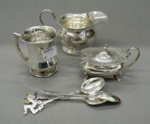 A silver cream jug, a mustard, a mug and spoons (7.