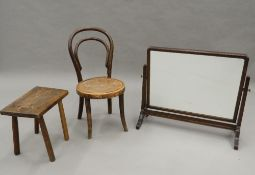 An early 20th century Bentwood child's chair, a stool and a toilet mirror. The mirror 60 cm wide.
