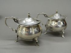 A pair of silver mustards (approximately 4.