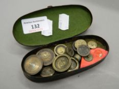 A case containing various 19th century brass weights. The case 12.5 cm wide.