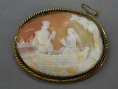 A cameo brooch. 6.5 cm wide.