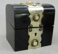 A Victorian ebonised casket containing cut glass perfume bottles, with key. 9.5 cm high.