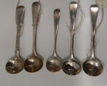Five silver salt spoons.