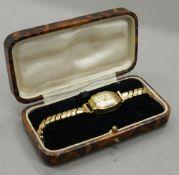 A Bucherer ladies wristwatch, cased.