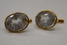A pair of unmarked gold earrings. 1.5 cm high (3.