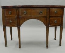 A bow front mahogany sideboard. 123 cm wide.