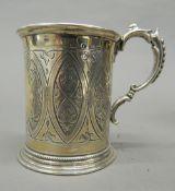 A silver Christening mug. 8.5 cm high (4.