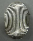 A Victorian silver vesta of oval ribbed form. 5 cm high (16 grammes).