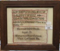 A framed sampler worked by Hannah Smith Slack, aged 10, of Misterton Board School.