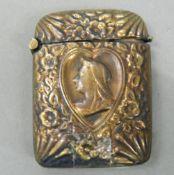 A vesta depicting Queen Victoria. 5.25 cm high.