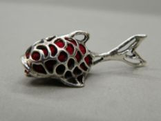 A silver pin cushion formed as a fish. 4.5 cm long.