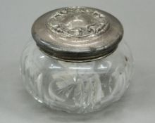 An American silver and cut glass dressing table jar. 7 cm high; 9 cm wide.