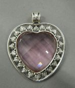 A large heart shaped pendant. 5.5 cm high including suspension loop.