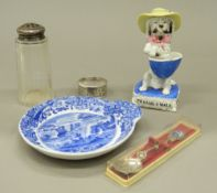A silver napkin ring, a silver topped caster, a Spode porcelain dish,