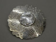 A large 19th century Scottish unmarked silver and rock crystal cloak badge. 8.5 cm diameter (59.