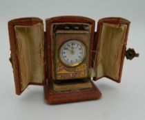 A silver and enamel pink miniature carriage clock in case. The case 6 cm high.