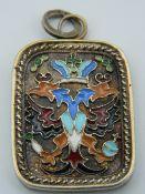 A silver gilt and enamel pendant. 3.75 cm high.