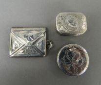 A small silver stamp case, a vinaigrette and a patch box.