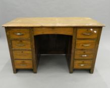 An early 20th century oak desk. 121 cm wide.