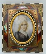 A fine 19th century miniature on ivory of a girl in an ornate frame,